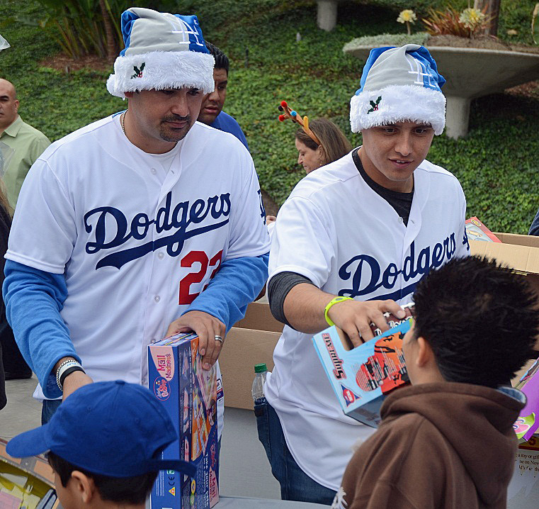 Adrian Gonzalez and Luis Cruz hand out present to youngsters at the annual Dodgers Christmas Party at Dodger Stadium. (Submitted by Mario Villegas 12-12-12)