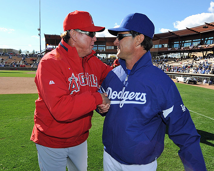 Mickey Hatcher exchanges pleasantries with Don Mattingly before a spring training game in 2011. Is there anyone who didn't expect Hatch to return to the Dodgers after his Pujols-induced firing from the Angels last month? (Photo by Jon SooHoo).
