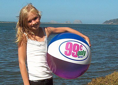 Even this young lady has enough sense to know where beach balls belong - AT THE BEACH. (Photo credit - beachballworld.com - seriously)
