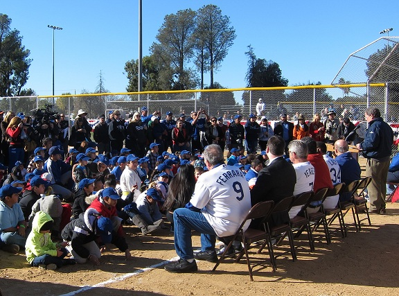 Former Dodgers Al Ferrara, Steve Yeager and Lee Lacy appeared genuinely appreciative as Dodgers broadcaster Charlie Steiner introduces them to the kids and parents on hand at Saturday's Dreamfield Dedication ceremony in Reseda.(Photo credit - Ron Cervenka
