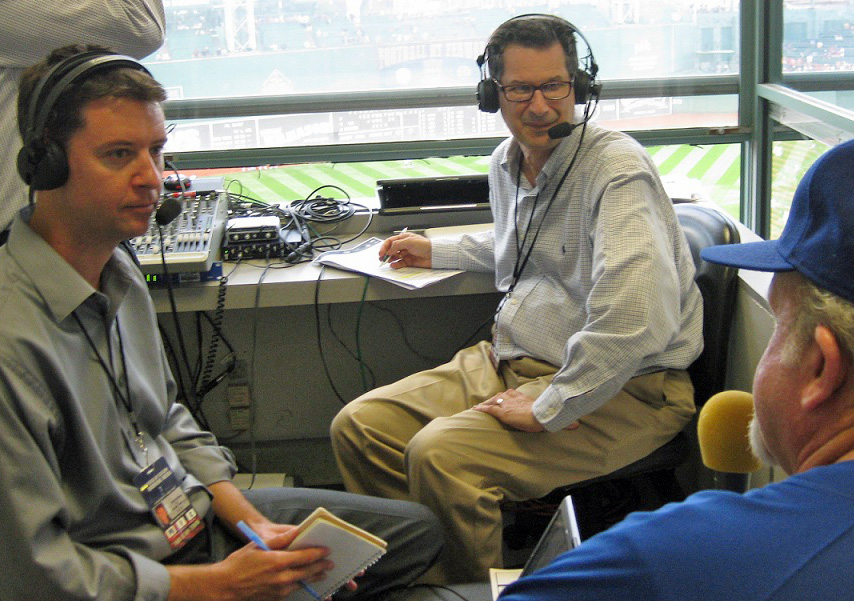 Former DodgerTalk Radio show hosts Josh Suchon (left) and Ken Levine (center) interview a Dodger fan at Fenway Park in 2010. (Photo credit Ron Cervenka)