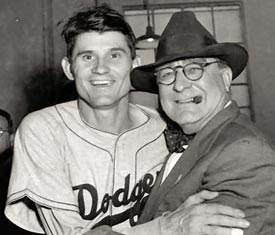 Roe is congratulated by Dodger GM Branch Rickey after winning game-2 of the 1949 World Series.(AP Photo)