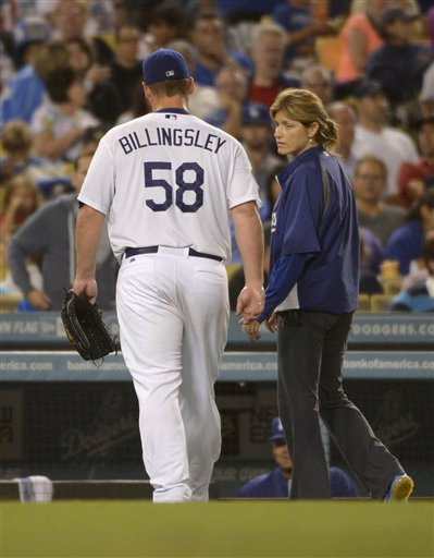 Chad Billingsley walks off the field with head trainer Sue Falsone after feeling pain in his right elbow on August 24, 2012. It would be his final appearance of the season. (Photo credit - Mark J. Terrill)