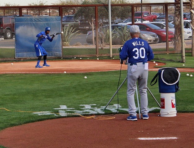 Dee Gordon receives instruction from the best in the business - Dodger legend Maury Wills.