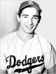 Former Dodgers GM Branch Rickey may have found Jackie Robinson, but he waited too late to sign Sandy Koufax when he was the Pirates GM in 1954. (AP photo)