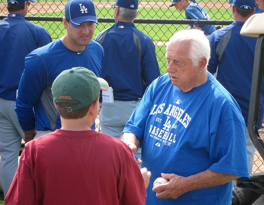 Tommy Lasorda signs more autographs each spring than any other Dodger - especially for kids. (Photo credit - Ron Cervenka)