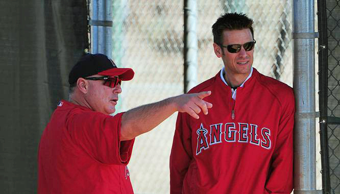 It's no secret that Angels manager Mike scioscia and general manager Jerry Dipoto have been known to strongly disagree on things from time to time. (Photo credit - Kyle Terada)