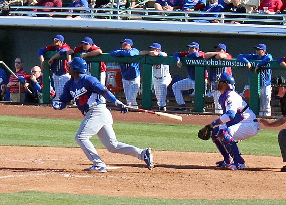 Yasiel Puig launches a double in a spring training game against the Cubs on February 27, 2013. (Photo credit - Ron Cervenka)