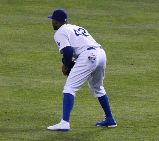 Although I can see why the MLB would have an issue with two different colored shoes. I certainly do not see why Carl Crawford cannot wear his Dodger Blue Air Jordan baseball shoes. (Photo credit - Ron Cervenka)