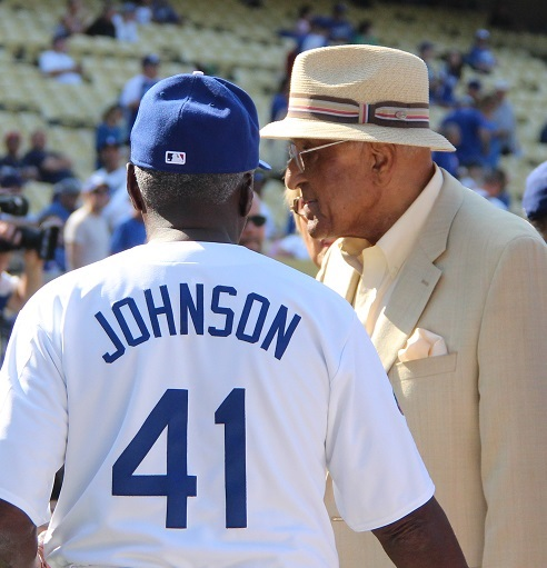 Brooklyn Dodger great Don Newcombe talks with Sweet Lou Johnson.
