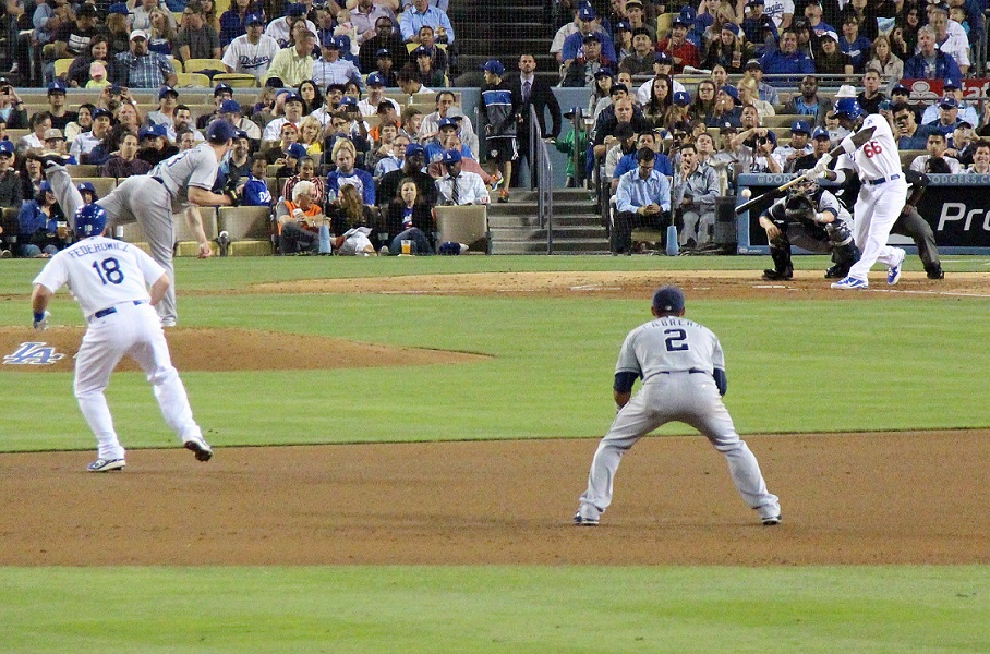 Yasiel Puig swings at a pitch that he is about to launch 439 feet into the Left Field Pavilion.