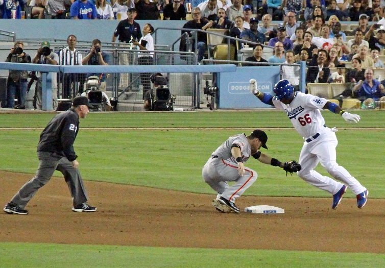 At some point Puig is going to realize that trying to stretch every single into a double isn't necessarily a good idea, but until he does, he sure is fun to watch trying it. (Photo credit - Ron Cervenka)