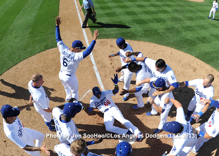 Yasiel Puig's walk-off home run on July 28, 2013, right in the middle of the Dodgers' historic 42-8 run, was arguably the most exciting home run during the run. It came in the 11th inning of a scoreless game against the Reds at Dodger Stadium. (Photo credit - Jon SooHoo)