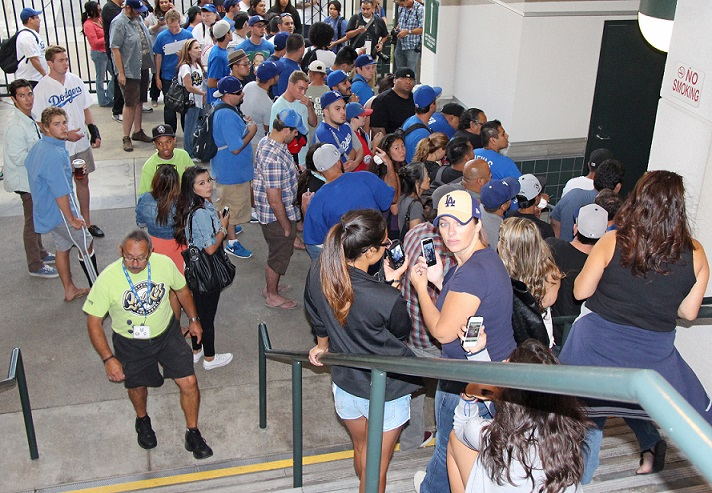 Fans were three and four deep and waited over two hours for Wilson to exit the Quakes clubhouse. To his credit, Wilson signed for most of them. (Photo credit - Ron Cervenka)