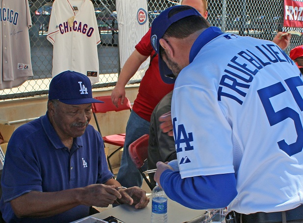 Lifelong Dodger fan Will Isabella gets an autograph from Dodger legend Tommy Davis during srping training 2013. Isabella ill no longer have the luxury of getting actual hard ticket stubs autographed. (Photo credit - Ron Cervenka)