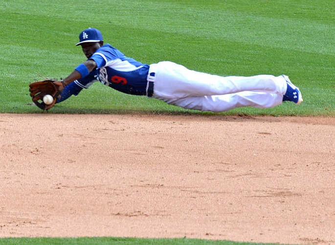 Dee Gordon made and outstanding diving stop in Tuesday's game against the Seattle Mariners. (Photo credit - Jon SooHoo)