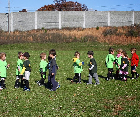 The post-game handshake is a pretty simple concept - and kids love it. (Photo courtesy of  jjromney.blogspot.com)
