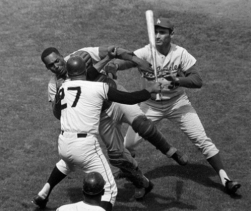 When asked to intentionally hit a Giants batter on xxxx, Dodgers Hall of Famer Sandy Koufax refused. Dodgers catcher Johnny Roseboro handled the matter and was subsequently hit on the head with a baseball bat by Giants pitcher Juan Marichal.  (Photo credit - Robert H. Houston)