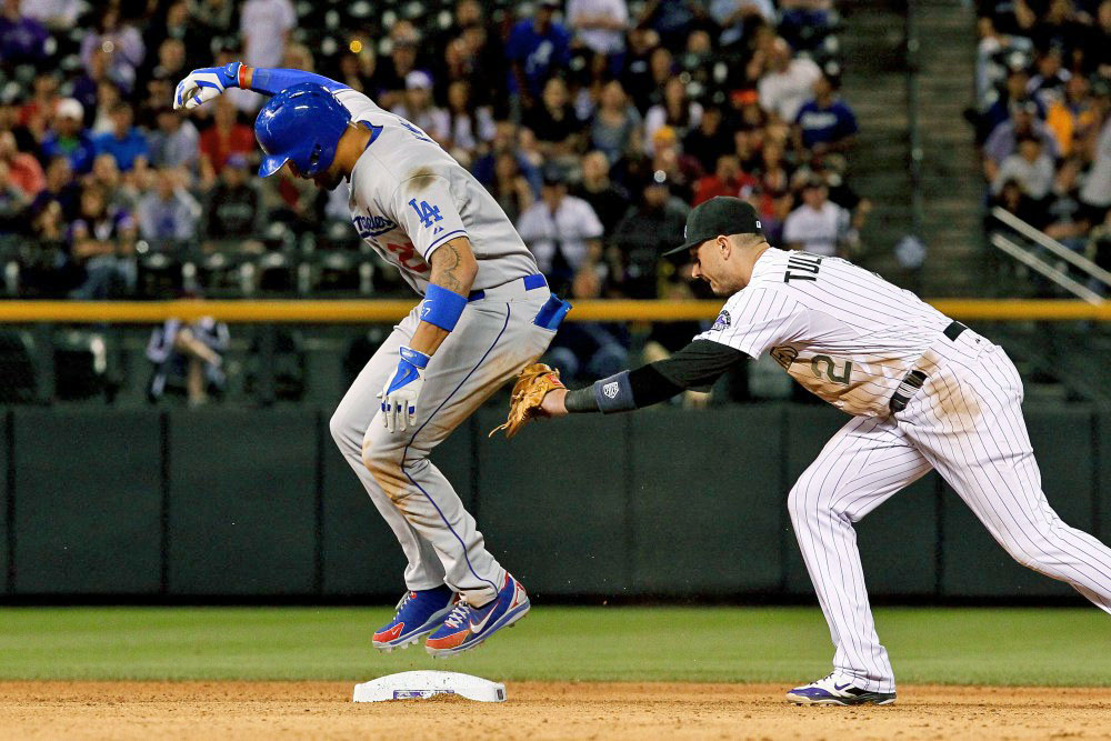 After being called safe on a double that Kemp initially thought was a home run and lollygagged out of the batters box, a video challenge of the play clearly showed that Kemp came off the bag while being tagged by Rockies shortstop Troy Tulowitzki. Kemp was also tagged out trying to stretch a single into a double later in the same game. (Photo credit - Isaiah J. Downing)