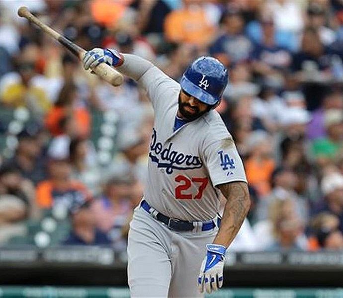 Dodgers slugger Matt Kemp slams his bat down after striking out with two outs and a runner at third base in Wednesday's 4-1 loss to the Tigers. Kemp actually broke his bat over his knee after striking out to end the 6th inning with two runners on base in Friday night's 6-3 loss to the padres. (Photo credit - Paul Sancya)