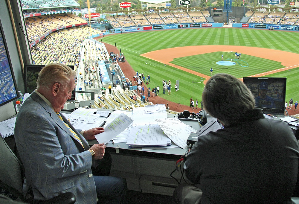 Boyd Robertson is both figuratively and literally Vin Scully's right-hand man - and there is nothing, absolutely nothing nothing that he would rather be doing. (Photo credit - Ron Cervenka)