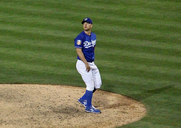 Dodgers right-hander Joe Blanton watches as White Sox shortstop Tyler Saladino's ball clears the left field fence on Saturday night at Camelback Ranch. (Photo credit - Ron Cervenka)
