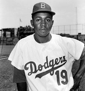 BROOKLYN, NY - 1950's:  Infielder Jim Gilliam #19 of the Brooklyn Dodgers poses for a portrait circa 1950's at Ebbets Field in Brooklyn, New York. Gilliam played his entire career in Brooklyn from 1953-57 and in Los Angeles 58-67. (Photo by Kidwiler Collection/Diamond Images/Getty Images)